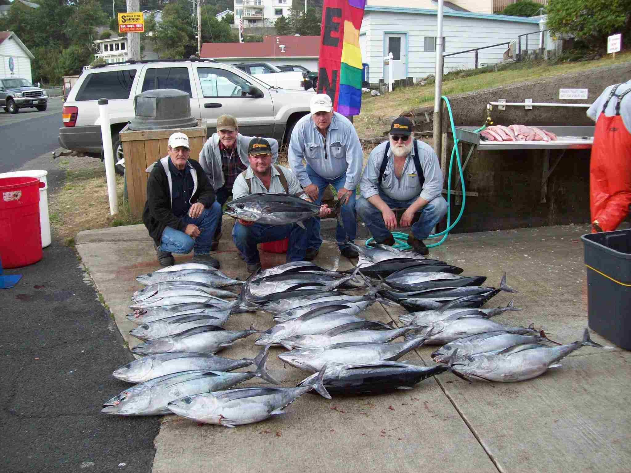 tuna fishing chartersBEING HELD IS A 46.5 POUNDER, WHAT A TUNA